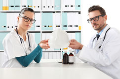 Medical health insurance concept, doctors hands with helmet Royalty Free Stock Photo