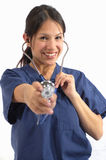 Medical Healthcare Nurse. A beautiful female medical healthcare nurse wearing scrubs and a stethoscope Royalty Free Stock Photos