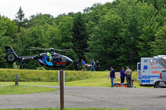 Medical Helecopter Flies in for Transport. BARNESVILLE, PA- JULY 3, 2016: A medical helicopter flies into Locust Lake State Park to transport a person needing Royalty Free Stock Image