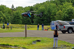 Medical Helecopter Flies in for Transport. BARNESVILLE, PA- JULY 3, 2016: A medical helicopter flies into Locust Lake State Park to transport a person needing Royalty Free Stock Photo