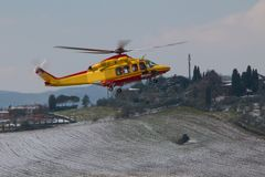 Medical helicopter landing. Yellow service medical elicopter landing in winter Stock Photography