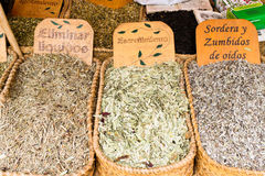 Medical herbs for sale on the market. Sant Cugat, Spain - September 28, 2014: Medical herbs for different conditions on a local market royalty free stock image