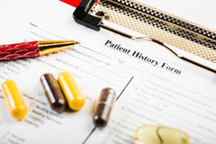 Medical history document with medicine Stock Photos