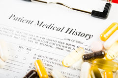 Medical history document with medicine Stock Images