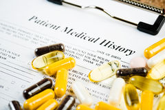 Medical history document with medicine Royalty Free Stock Images