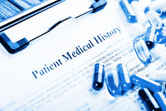 Medical history document with medicine Royalty Free Stock Photo