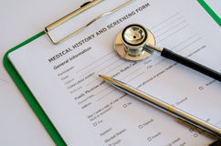 Medical History form and a doctor's Stethoscope. Royalty Free Stock Images