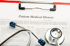 Medical history with stethoscope Stock Image