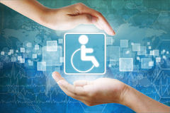 Disabled symbol in hand Stock Images