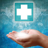 Medical icon First Aid in hand. On Medicine background Royalty Free Stock Image