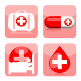 Medical icons. Medical icon set with first aid kit, drugs, hospital and blood drop  on white background Royalty Free Stock Images