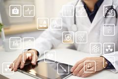 Medical icons on virtual screen. Modern technology in medicine.