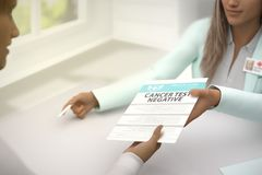 Medical illustration with selective focus - fantastic lady medical doctor gives patient negative Cancer test results to sign in a royalty free stock images