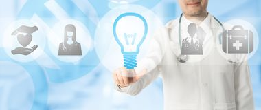 Medical Innovation Concept - Doctor with Lamp Icon. Medical Innovation Concept - Doctor points at lamp or light bulb icon with other medical icons showing symbol royalty free illustration