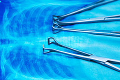 Medical instruments on anatomy background stock photo