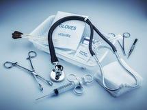 Medical instruments. For ENT doctor on pale blue Stock Image