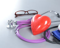 Medical instruments, stethoscope and red heart closeup shot Stock Photography