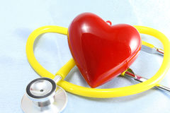 Medical instruments, stethoscope and red heart closeup shot Royalty Free Stock Photos