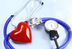 Medical instruments, stethoscope and red heart closeup shot Stock Photos