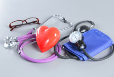 Medical instruments, stethoscope and red heart for ENT Royalty Free Stock Photography
