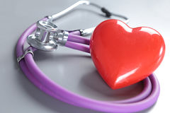 Medical instruments, stethoscope and red heart for ENT Royalty Free Stock Photos