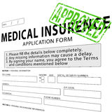 Medical insurance application form with green approved stamp Royalty Free Stock Photo