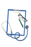 Medical insurance and healthcare concept,  clipboard glasses and Royalty Free Stock Photos