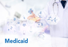 Medical insurance and Medicaid and stethoscope. Medicine doctor working with computer interface as medical Stock Image