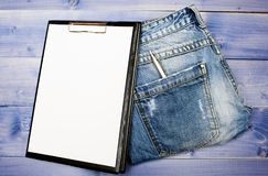 Medical insurance. Paper tablet and pen on jeans background copy space. History of the disease. Medical treatment. Medical help and consultation. Interviewing royalty free stock images