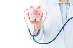 Medical insurance, piggybank with stethoscope Royalty Free Stock Photography