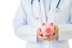 Medical insurance, piggybank with stethoscope Royalty Free Stock Photos
