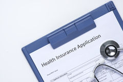 Medical insurance records, pen and Stethoscope Royalty Free Stock Image