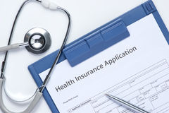 Medical insurance records, pen and Stethoscope Royalty Free Stock Images