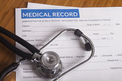 Medical insurance records and Stethoscope Royalty Free Stock Image