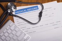 Medical insurance records and Stethoscope. Stethoscope resting on a sheet of medical insurance records Royalty Free Stock Photography