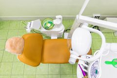 Medical interior, dental office with an orange chair, lamp and equipment. stomatology concept top view. Medical interior, dental office with an orange chair stock images