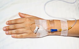 Medical intravenous cannula on hand Royalty Free Stock Images