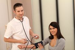 Medical Investigation. Brunette Doctor with a female patient stock photo