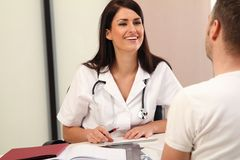 Medical Investigation. Brunette Doctor with a patient stock images