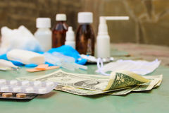 Medical items and money Stock Photo