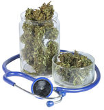 Medical jar with marijuana. And Doctors stethoscope Royalty Free Stock Photography