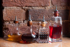 Medical jars with colorful potions on brick wall background. Medicine bottle. Old pharmacy bottles. Stock Photo