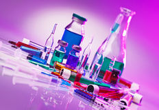 Medical laboratory glass equipment still life. On blue purple stock photo