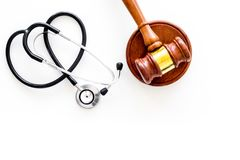 Medical law, health law concept. Gavel and stethoscope on white backgound top view copy space stock images