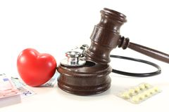 Medical law with heart. Medical law - with judges gavel, stethoscope, tablets and euro notes royalty free stock image