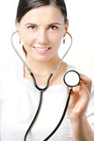 Medical life. Cute girl in white medical gown and a stethoscope Royalty Free Stock Photography