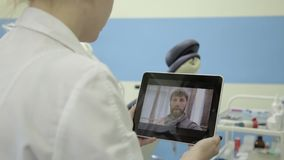 Medical on-line consultations. male senior patient video chatting with doctor on pc tablet stock video