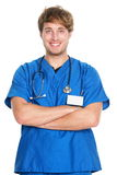 Medical male nurse / doctor. Medical portrait. Male nurse or young man doctor smiling happy and proud in blue scrubs isolated on white background. Young Royalty Free Stock Images