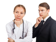 Medical malpractice. Doctor and her lawyer thinking about how to solve the problem royalty free stock photos