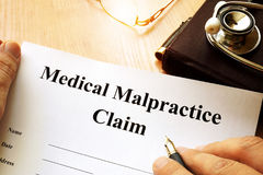 Medical Malpractice Claim. Medical Malpractice Claim on a table royalty free stock photos